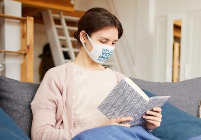 Face Mask Mockup of a Woman Reading at Home M3716-r-el2