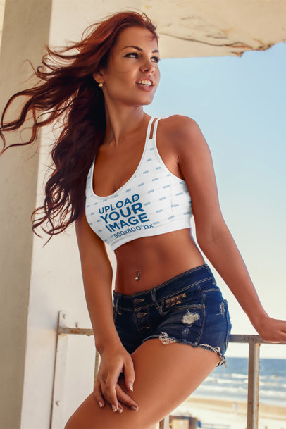 Sports Bra Mockup of a Woman Posing on a Balcony with a Beach View 39632-r-el2