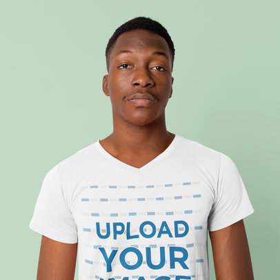 Mockup of a Serious Man Wearing a V-Neck Tee in a Studio 40416-r-el2