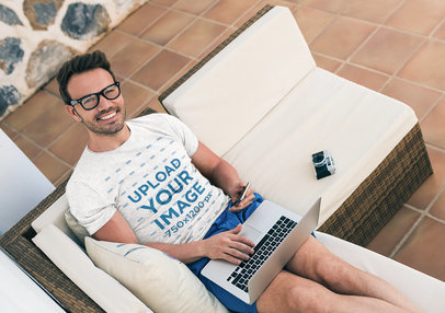Heather T-Shirt Mockup of a Happy Man Working in His Living Room 40115-r-el2