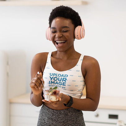 Sports Bra Mockup of a Happy Woman Listening to Music While Having Breakfast m6476-r-el2