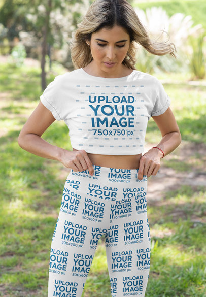 Crop Top Tee and Bike Shorts Mockup Featuring a Woman at a Park 42383a