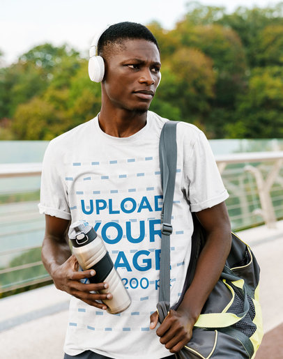 Mockup of a Serious Man Wearing a T-Shirt and Headphones M4336-r-el2