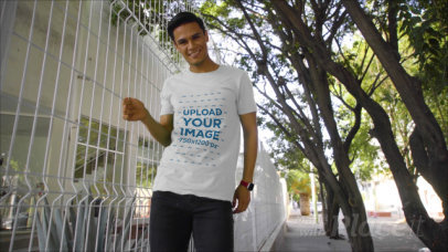 T-Shirt Video of a Young Man Posing by a Fence 3107v