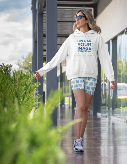 Mockup of a Woman Wearing a Fitness Outfit with a Hoodie and Biker Shorts 42379a