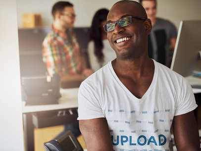 V-Neck T-Shirt Mockup of a Happy Man in a Coworking Space 38952-r-el2