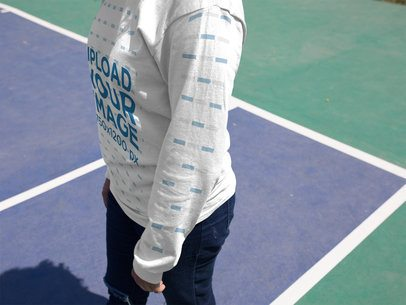 Closeup Mockup of a Girl Wearing a Long Sleeved Tee While at a Tennis Court a15978