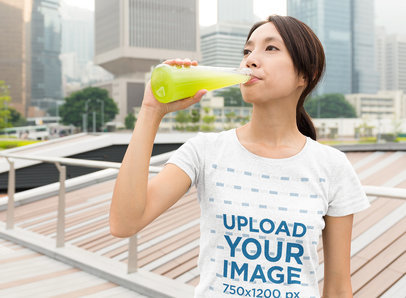 Heather T-Shirt Mockup of a Woman Drinking Juice in the City 46711-r-el2