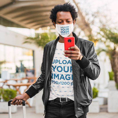 Face Mask Mockup of a Man Wearing a T-Shirt and Checking His Phone 45778-r-el2