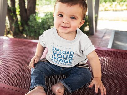 Little Baby Boy Looking to the Camera Wearing a T-Shirt Template While Sitting Down 16090