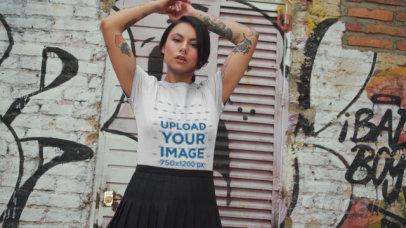 T-Shirt Video Featuring a Tattooed Woman Posing Against a Graffiti Wall 3117v