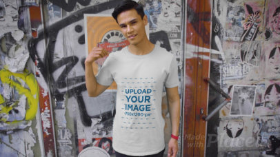 T-Shirt Video Featuring a Man Posing Against a Graffiti Wall 3114v