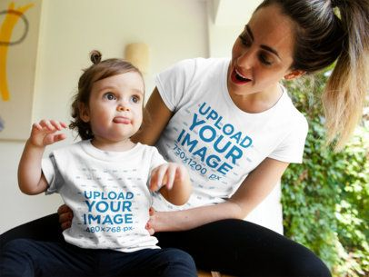 Mockup of a Mom and Baby Girl Wearing Different Tshirts While Talking a16084
