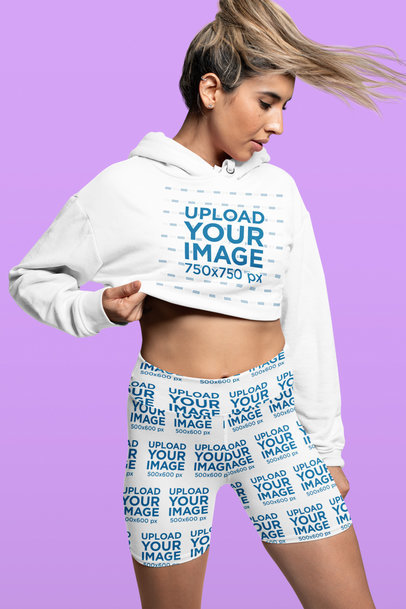 Crop Top Hoodie Mockup of a Woman Wearing Sublimated Biker Shorts at a Studio 42355a
