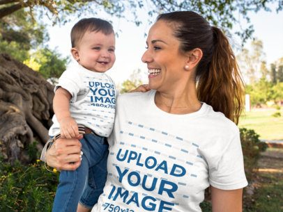 Baby Boy Smiling with His Mom Wearing Different Round Neck T-Shirts Mockup Outdoors a16103