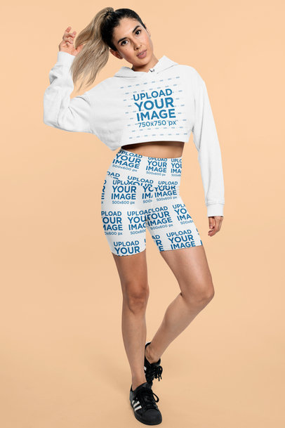 Crop Top Hoodie and Bike Shorts Mockup Featuring a Woman at a Studio 42350a