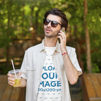 T-Shirt Mockup of a Man Holding a Lemonade and Talking on the Phone M8259-r-el2
