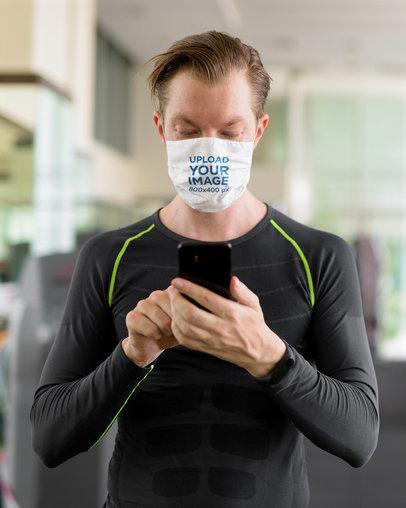 Face Mask Mockup of a Man Using His Phone at the Gym 44021-r-el2