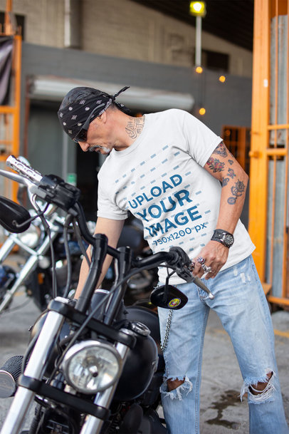 T-Shirt Mockup of a Middle-Aged Biker Fixing His Motorcycle's Seat 20245a