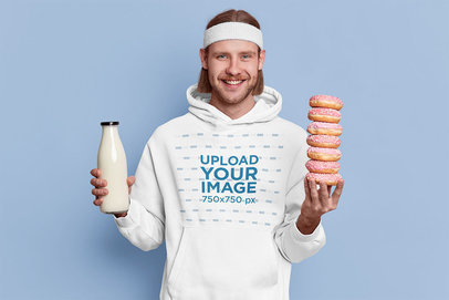 Hoodie Mockup of a Man Holding Some Milk and Donuts m3730-r-el2