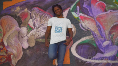 T-Shirt Video of a Tall Man Posing in Front of an Urban Mural 3430v