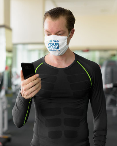 Face Mask Mockup of a Man at a Gym Checking His Phone 43818-r-el2