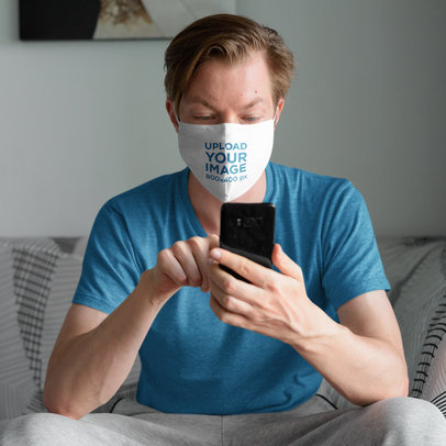 Face Mask Mockup of a Man on His Couch Checking His Phone 43826-r-el2