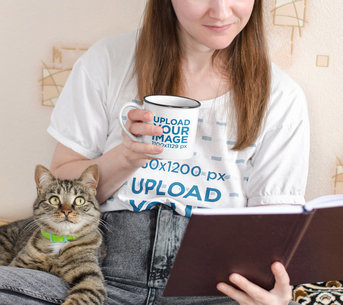 T-Shirt Mockup of a Woman Reading While Drinking From a 12 oz Enamel Mug m8803-r-el2
