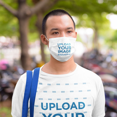 Face Mask and Tee Mockup of a Young Man Standing Outdoors 42831-r-el2