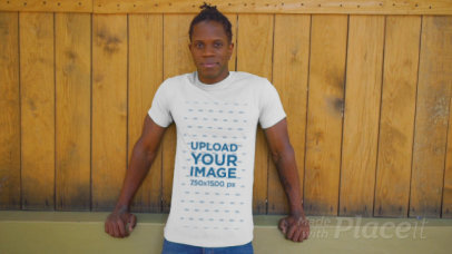 T-Shirt Video of a Man Posing by a Wooden Fence 3396v