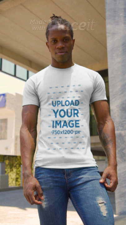 Video of a Muscular Man Pointing at His T-Shirt 3394v