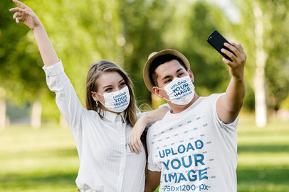 Tee and Face Mask Mockup Featuring a Happy Couple Taking a Selfie at the Park 43783-r-el2