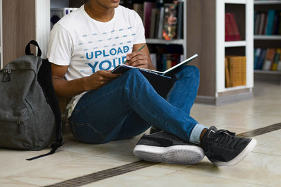 Round-Neck Tee Mockup of a Man Taking Notes on a Library's Floor 38909-r-el2