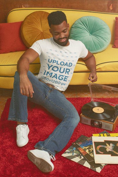 T-Shirt Mockup of a Man Listening to a Record with a 70's Aesthetic m10519