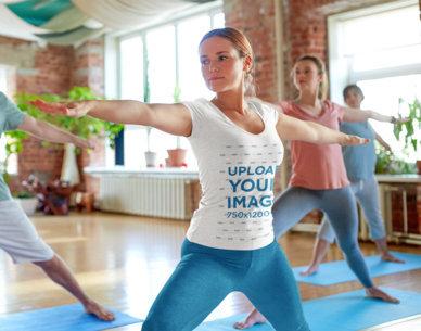 V-Neck Tee Mockup of a Woman at an Indoor Yoga Class 42943-r-el2