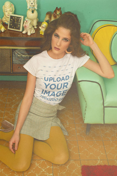T-Shirt Mockup of a Woman Posing in a 70's-Decorated Living Room m10528