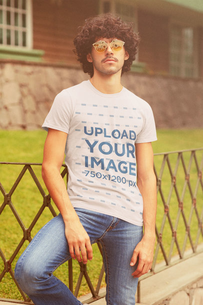T-Shirt Mockup of a Curly-Haired Man With a Retro Style m10121