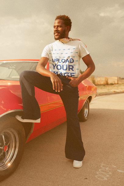 T-Shirt Mockup of a Man Posing by a Classic Car m10492