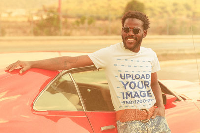 T-Shirt Mockup of a Man Posing With an Old Car m10480