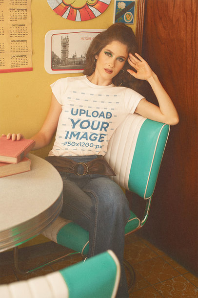 T-Shirt Mockup of a Woman in a Dining Room with a 70's Aesthetic m10536