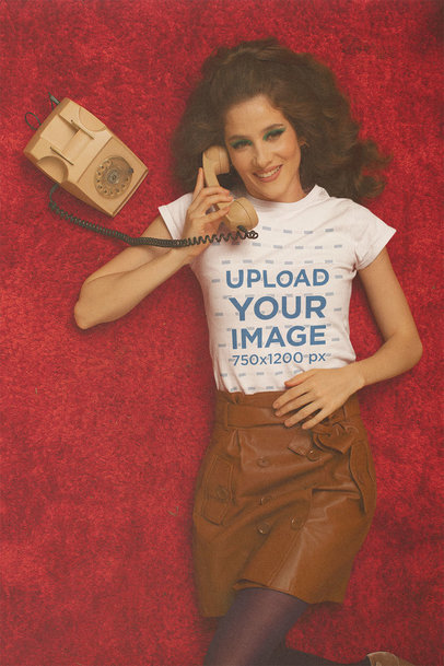 T-Shirt Mockup Featuring a Woman Talking on a Retro Telephone m10533