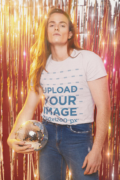T-Shirt Mockup with a Long-Haired Man Holding a Disco Ball in His Hand m10147