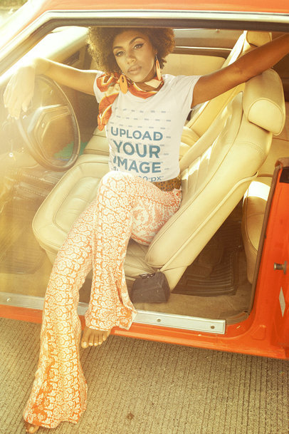T-Shirt Mockup of a Woman Posing on the Seat of a Retro Car m10511