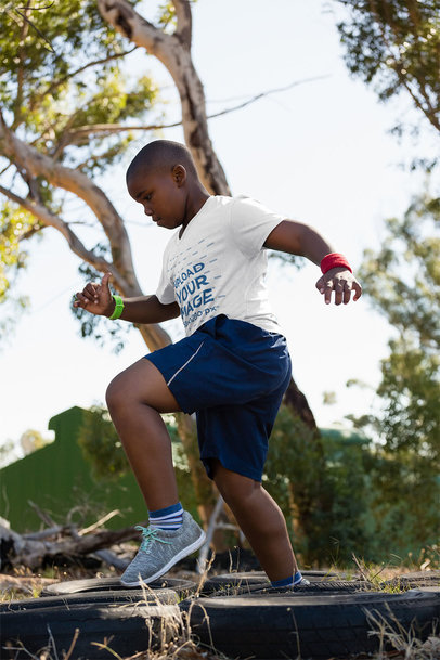 T-Shirt Mockup of a Boy Running Through an Obstacle Course 40739-r-el2