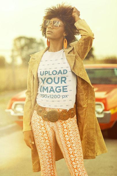 T-Shirt Mockup of a Curly Hair Woman Posing Near a Vintage Car m10512