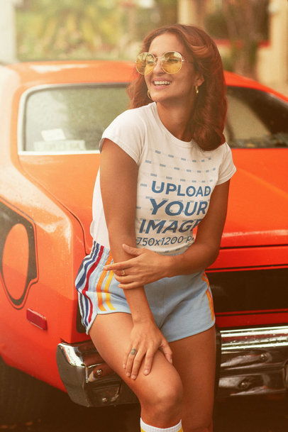 Retro-Styled T-Shirt Mockup Featuring a Happy Woman and a Vintage Car m10136
