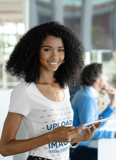Scoop-Neck T-Shirt Mockup of a Young Woman at Work 41854-r-el2