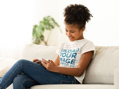 T-Shirt Mockup of a Girl Watching Something on Her Phone 45724-r-el2