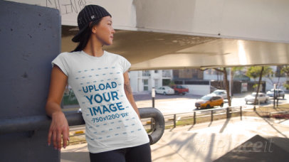 T-Shirt Video of a Woman with an Arm Tattoo Posing by Passing Cars 3426v