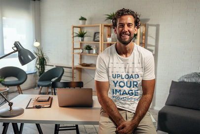 T-Shirt Mockup of a Happy Man Leaning on His Desk at Home M10252-r-el2